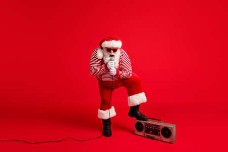 Full length body size view of his he handsome bearded fat overweight Santa vocalist singing hit having fun leisure entertainment vocal voice isolated bright vivid shine vibrant red color background