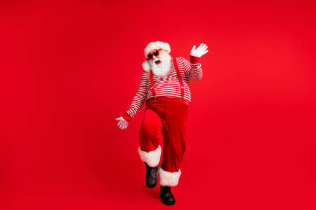 Full length body size view of his he nice handsome attractive cheerful cheery Santa father dancing having fun celebration festal day x-mas isolated bright vivid shine vibrant red color background