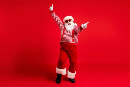 Full length body size view of his he nice handsome attractive cheerful cheery ecstatic Santa dancing rest relax x-mas having fun isolated bright vivid shine vibrant red color background Stock fotó