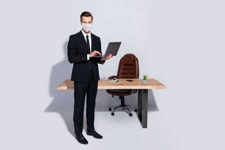 Full body photo of handsome business guy hold notebook hands wear white face mask isolated grey background
