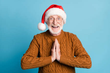 Close-up portrait of bearded grey-haired Santa father asking gift North Pole Eve Noel day