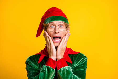 Close-up portrait of his he nice attractive amazed glad cheerful cheery funny guy elf Eve Noel newyear party wow December sale isolated over bright vivid shine vibrant yellow color background