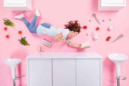 Top above high angle view full length profile side photo girl flatlay drink coffee read cookbook prepare fresh veggie breakfast have tomato eggs mushroom isolated pastel color background