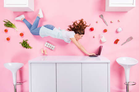 Top above high angle view full size profile side photo positive shocked woman flat lay kitchen watch find video menu recipe laptop have tomato eggs herbs isolated pastel color background