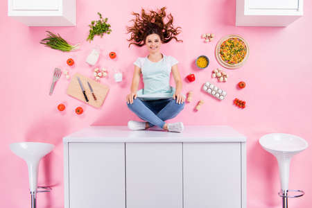 Top above high angle view full size photo of positive girl sit table prepare yummy pizza enjoy supper breakfast meal flat lay eggs tomato knife isolated over pastel color background