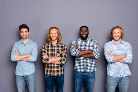 Portrait of four nice attractive content cheerful cheery virile guys best buddy fellow coworkers colleagues folded arms isolated over gray purple pastel color background Banque d'images