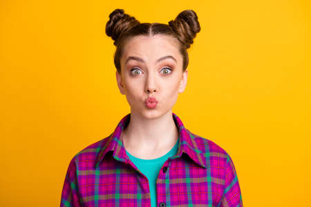 Close-up portrait of her she nice attractive pretty cute funky flirty girl wearing checked shirt sending air kiss isolated over bright vivid shine vibrant yellow color background