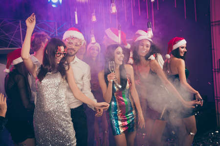 Photo of people party bearded man dance with girl rejoice wear glossy dress santa spectacles cap stylish outfit modern club indoors