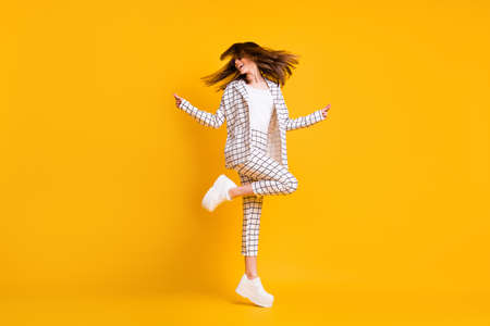 Full length body size side profile photo of girl wearing white checkered suit roung sunglass dancing isolated on vivid color background Stock Photo