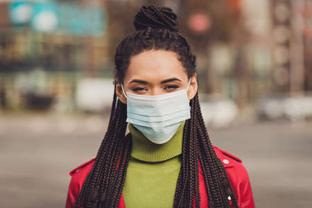 Photo of young afro woman walk city wear medical mask prevention protection corona virus covid-19 quarantine