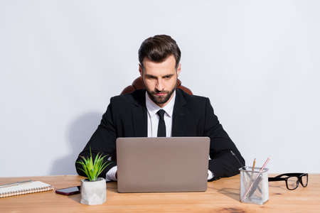 Photo of handsome boss business guy look notebook table writing colleagues seriously reliable person corporate chatting wear black blazer shirt suit sit chair isolated grey background