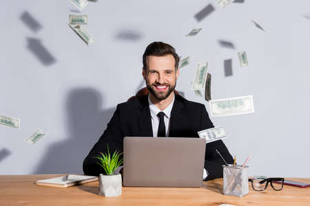 Photo of handsome business guy notebook table bucks american falling toothy smiling rich chief successful startup income wear blazer shirt tie suit sit chair isolated grey background