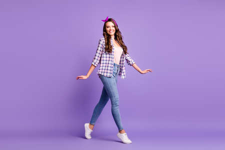 Full length profile photo of lady go tiptoes wear plaid shirt vintage headband jeans footwear isolated purple color background