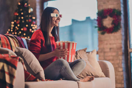 Photo of young smiling cheerful happy good mood woman sit sofa eat popcorn watch 3-D movie in 3d glasses at home house