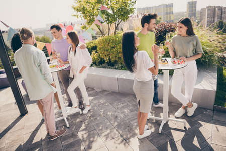 Full size photo of company of friends communicating hands hold champagne glass gathering restaurant outdoors 写真素材