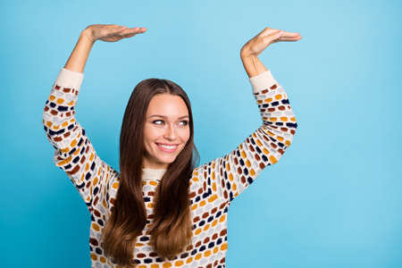 Photo of funny sweet young woman dressed ornament pullover dancing looking empty space isolated blue color background Stok Fotoğraf