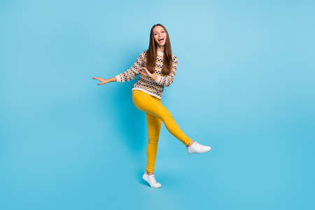 Photo of adorable shiny young woman dressed ornament pullover dancing isolated blue color background Stok Fotoğraf