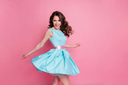 Profile photo of amazing tender lady having fun event prom party dancing night club chilling with friends skirt flying air wear blue teal mini dress isolated pastel pink color background