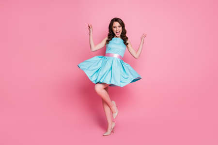 Full length body size view of her she nice-looking attractive lovely pretty smart charming cheerful cheery wavy-haired girl having fun dancing moving isolated over pink pastel color background