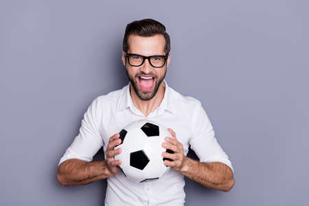 Close-up portrait of his he nice attractive successful cheerful cheery glad man holding in hands ball pass throw match leisure isolated over grey violet purple pastel color background