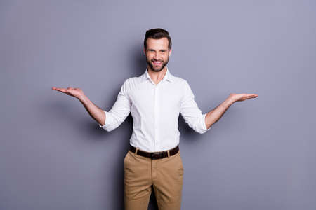 Portrait of positive cheerful man real estate agent economist chief hold hand recommend choose decide choice decisions wear white shirt trousers isolated over gray color background