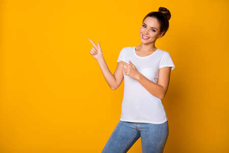 Portrait of positive cheerful promoter girl point index finger copyspace indicate ads promotion wear good look clothes isolated over bright color background