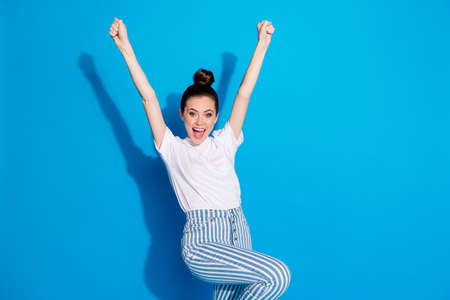 Portrait of her she nice attractive pretty charming ecstatic cheerful cheery teen girl rejoicing having fun pass exam test holiday vacation isolated on bright vivid sine vibrant blue color background