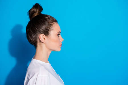 Close-up profile side view portrait of her she nice-looking attractive pretty lovely serious content girl modern new season look coiffure isolated over bright vivid sine vibrant blue color background