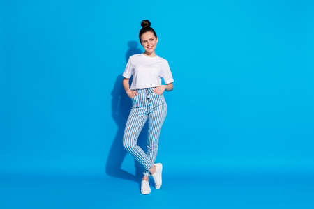 Full length body size view of her she nice attractive lovely pretty charming cheerful cheery teen girl posing free time leisure isolated over bright vivid sine vibrant blue color background