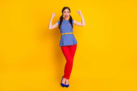 Full length body size view of her she nice attractive pretty glad cheerful cheery fashionable girl celebrating attainment good luck news isolated bright vivid shine vibrant yellow color background