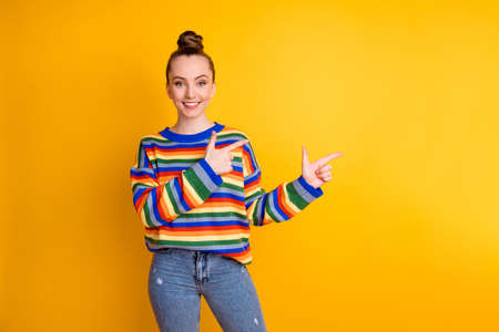 Photo of positive cheerful girl promoter point index finger copyspace decide choose advise ads promotion wear jumper isolated over bright color background