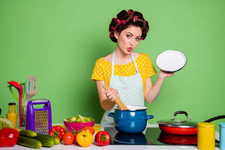 Portrait of her she nice attractive pretty coquettish mature glamorous housewife cooking noodle soup meal pout lips learning workshop isolated over green pastel color background