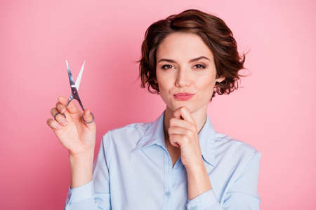 Closeup photo of attractive lady hold professional scissors look client want excited cut hair change style wear blue shirt isolated pink pastel color background