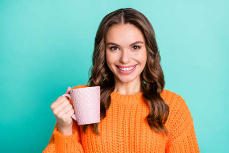 Photo of young attractive girl happy positive smile enjoy morning cup of coffee isolated over turquoise color background