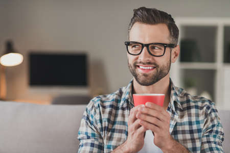 Photo of young handsome cheerful man happy positive smile dream dreamy look empty space enjoy morning cup of coffee