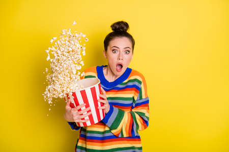 Photo of young woman watch horror movie terrified horrified scared isolated over yellow color background