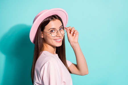 Close-up profile side view portrait of her she nice attractive cheerful pretty brown-haired girl copy space touching specs isolated bright vivid shine vibrant green turquoise color background