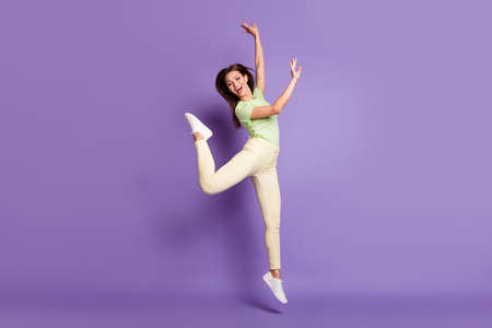 Full length body size view of nice attractive slender flexible cheerful cheery girl jumping having fun aerobics choreography isolated bright vivid shine vibrant lilac violet color background