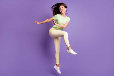Full length body size view of nice attractive pretty slender cheerful cheery girl jumping dancing having fun rest party isolated bright vivid shine vibrant lilac violet color background Stock fotó