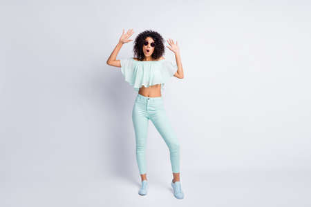 Full length body size photo of amazed playful mulatto girl wearing mint outlook opened mouth isolated on grey color background