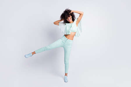 Full length body size photo of carefree playful mulatto curly girl in sunglass chilling at party isolated on grey color background