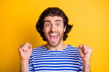Portrait of ecstatic crazy middle eastern man scream raise fists wear nautical vest isolated over shine color background