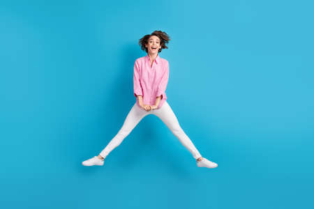 Full body photo of cheerful lady jump wear formal clothes sneakers isolated over blue pastel color background