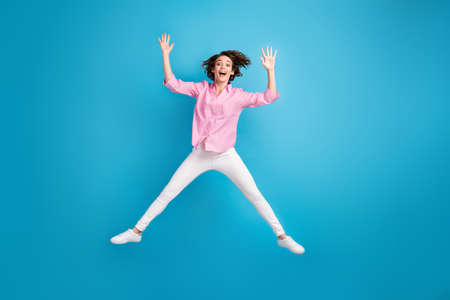 Full length photo of active careless girl jump wear pink white formal outfit isolated over blue color background