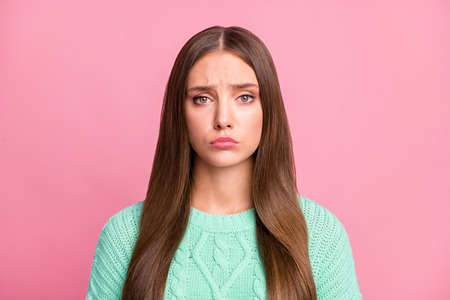 Close up portrait of dissatisfied person moody sullen lips wear turquoise pullover isolated on pink color background