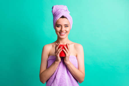 Portrait photo of adorable lady after taking shower drink hot cacao wear violet towels isolated teal color background