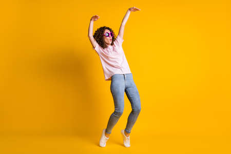 Photo portrait full body view of girl dancing making wave with whole body isolated on vivid yellow colored background