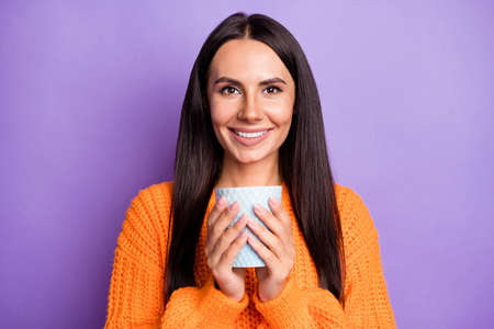 Photo of adorable person hands hold drink cup toothy smile wear sweater isolated on violet color background