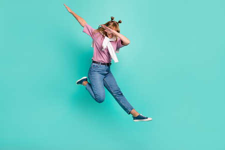 Full size photo of young happy cheerful girl with jumper on shoulders hold hand in air isolated on turuoise color background Standard-Bild
