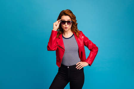 Portrait of her she nice-looking attractive lovely lovable pretty cheerful wavy-haired girl posing touching specs sending you air kiss isolated over bright vivid shine vibrant blue color background